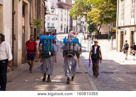 SANTIAGO SPAIN - AUGUST 17: Nuns pilgrimn go to the Santiago cathedral Way of St. James on August 17 2016 on August 17 2016