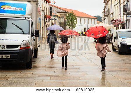 SANTIAGO SPAIN - AUGUST 17: Girl twins walking in the Santiago street on August 17 2016