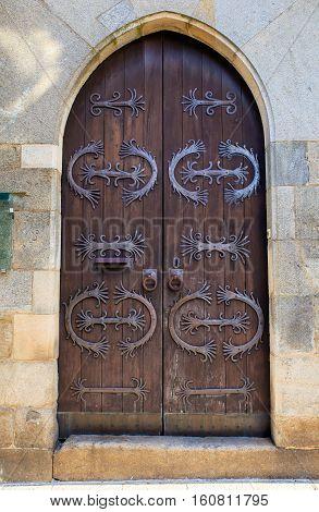 View of the antique decorated door in Santiago de Compostela