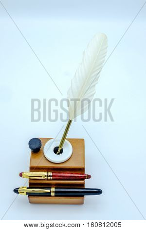 Feather Pen And Fountain Pen In A Inkwell