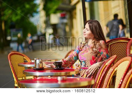 Beautiful Young Woman In Parisian Cafe