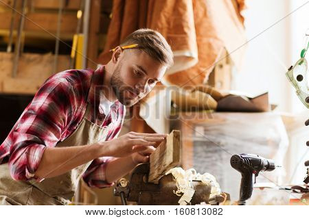 profession, carpentry, woodwork and people concept - carpenter testing wood plank evenness at workshop