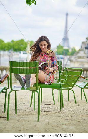 Young Parisian Woman Reading A Book