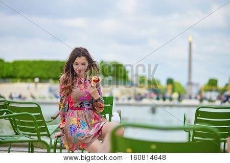 Young Parisian Woman Eating Ice Cream