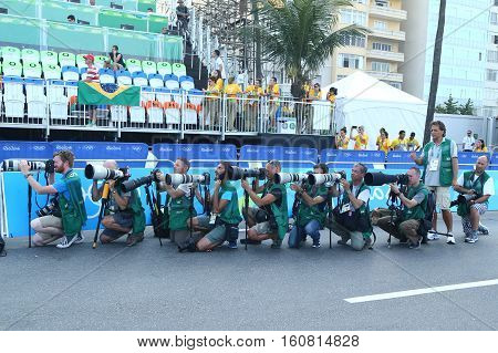 RIO DE JANEIRO, BRAZIL - AUGUST 6, 2016: Sport photographers shooting at finish line during men Cycling Road competition of the Rio 2016 Olympic Games at Copacabana Beach in Rio de Janeiro