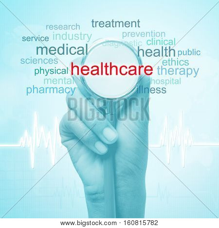 hand holding stethoscope with healthcare word. medical concept