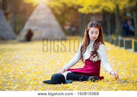 Beautiful Girl With Yellow Leaves In Nami Island, Korea. Nami Island In Autumn.
