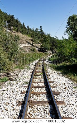 Old railway tracks running through in the Bulgarian mountains