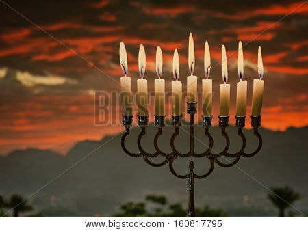 Jewish menorah with burning candles is traditional symbol for Hanukkah Holiday