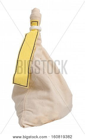 A bag with a yellow label, filled with coins or other small objects like Santa Claus