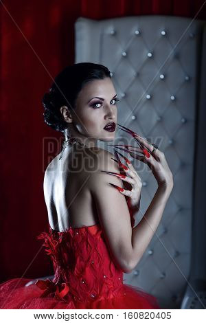 femme fatale vamp in red dress and the white throne