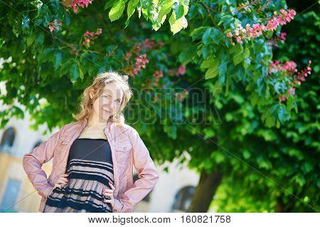 Beautiful Parisian Woman In Palais Royal Garden