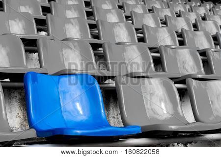 Blue seat in White seats. in stadium.