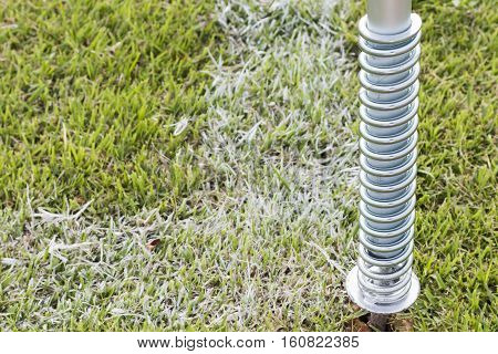 Fastener or spring on grass. in a footbal stadium.