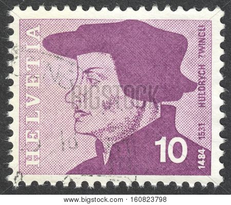 MOSCOW RUSSIA - CIRCA NOVEMBER 2016: a post stamp printed in SWITZERLAND shows a portrait of Huldrych Zwingli the reformer the series