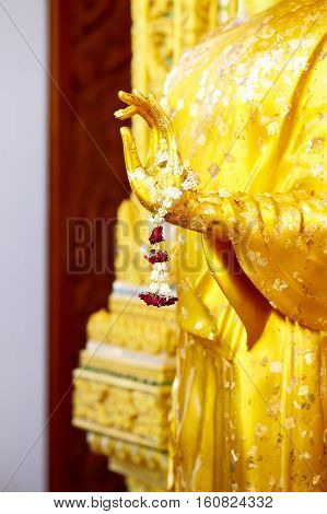 Golden hands of buddha statue in temple Thailand.selective focus.