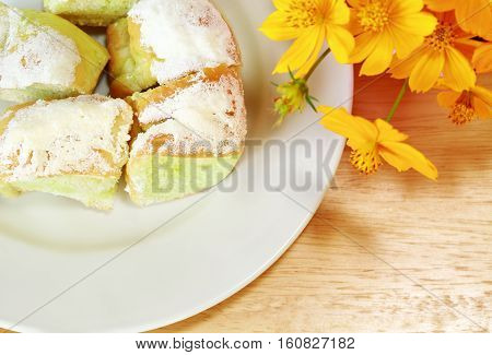 Sweet butter bread of dish on wooden table.