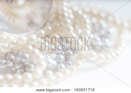 Abstract blurred background pearl necklace on white. Macro shot Shallow depth of field defocused