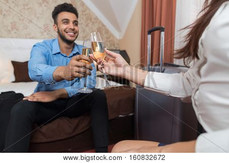 Latin Businessman Sitting At Bed In Room With Businesswoman Drink Champange Business Man And Woman Arriving To Hotel