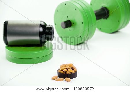 dumbbells and nutritional supplements for bodybuilding. sports nutrition. barbell.