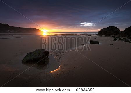 Caswell Bay sunrise Sunrise at Caswell Bay, one of the most popular and easily accessible beaches on the Gower peninsula in Swansea