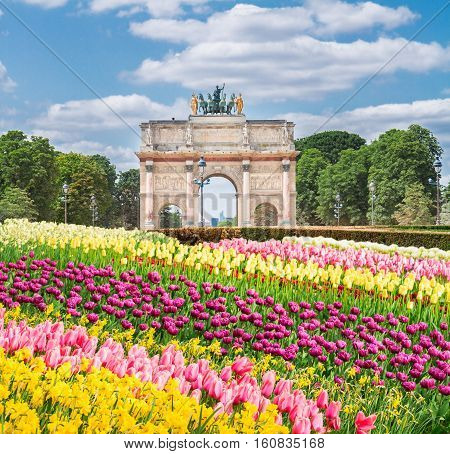 Arc de Triomphe du Carrousel in Tuileries Garden at sunny spring day, Paris, France