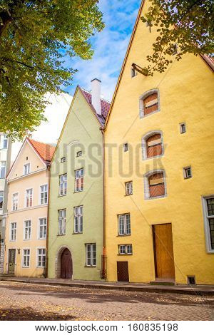 Three colourful residential houses in the old town of Tallin, Estonia