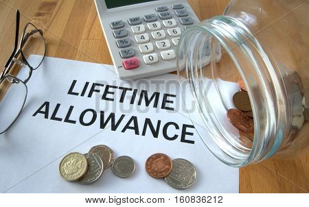 Lifetime Allowance with coins on paper and in pot and calculator behind