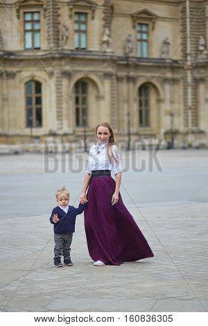 Beautiful Young Mother And Her Adorable Toddler Son In Paris