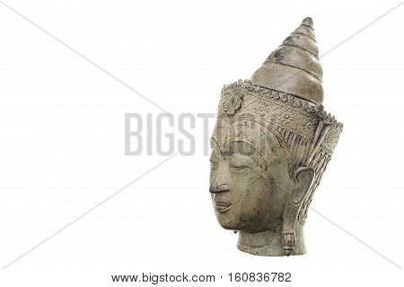 A traditional ornate Buddha head in serene Zen mediation pose. Connotations of calm peaceful contemplation and meditation leading to enlightenment. Against a white background with copy space.