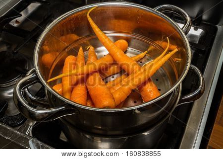 Carrots Being Steamed On Cooker.