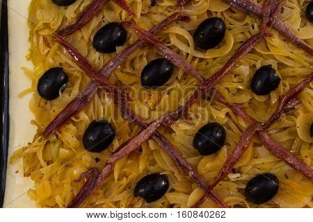 French Anchovy, Olive  Onion Tart Pissaladiere Uncooked