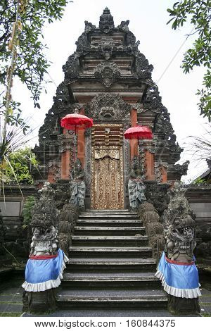 ornate gate of the Saraswati hindu temple ubud bali indonesia