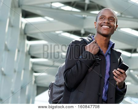 Handsome Black Businessman Traveling With Bag And Cell Phone