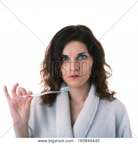 Smiling young woman in bath robe close up over white isolated background with toothbrush, morning, healthy, relaxation and beauty concept