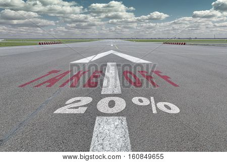 Runway of airport with arrow guideline take off and 20 percent sign printed on the asphalt