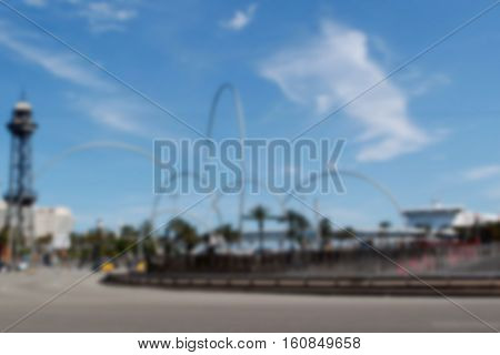 Barcelona square view in blur. Modern city of Spain. Modern sculpture on square by seaside. Blurry landscape of Barcelona town. Tourism and sightseeing in Europe blurry photo for banner background