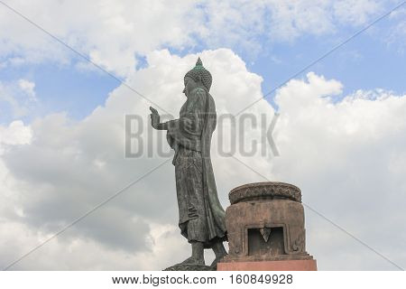 Big Buddha statue ancient on blue sky and raincloud background in Nakhon Pathom Province of Thailand