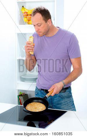 Man Cooking Pancake In The Kitchen
