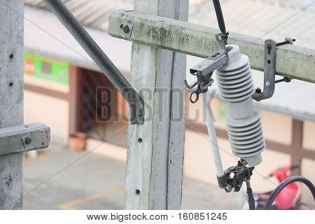 Electricity  porcelain insulators on pole outdoors building