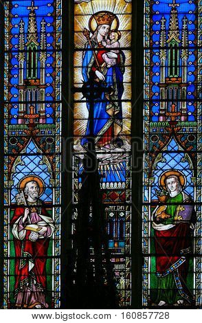 Stained Glass - Saints Peter And John And Mother Mary