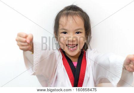 Asian girl posting Taekwondo Punch on white background.
