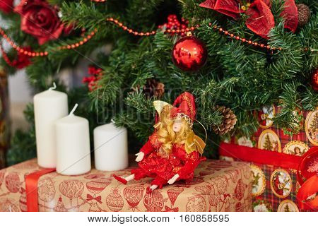 Beautiful Christmas decor, New year toys, glow in the dark garland. Christmas tree decorated with toys and balloons. Festive mood before Christmas eve. The house is decorated before the holiday