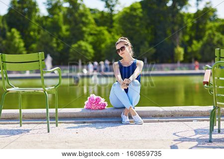 Young Parisian Woman With Pink Peonies