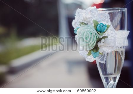 a nice glass of champagne stands alone outside marriage, wedding