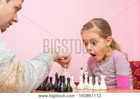 My Daughter Was Surprised And Opened Her Mouth When Dad Killed Another Piece On The Chessboard
