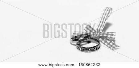 Wedding rings and ribbon, holiday, happy and love