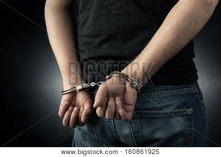 The man is arrested and handcuffed high quality and high resolution studio shoot