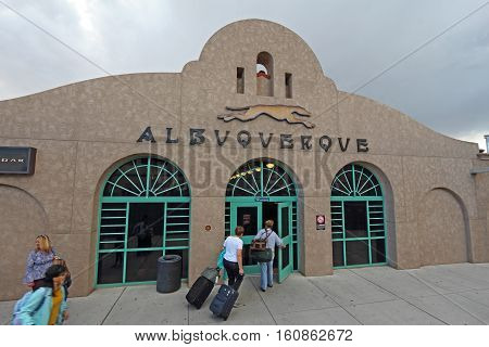 ALBUQUERQUE NEW MEXICO - OCTOBER 9 2016: Passengers from the Southwest Chief line with luggage enter the Amtrak train station from the platform near the tracks in Albuquerque New Mexico.