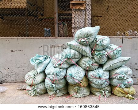 Stack of sandbags for construction worker to build the wall